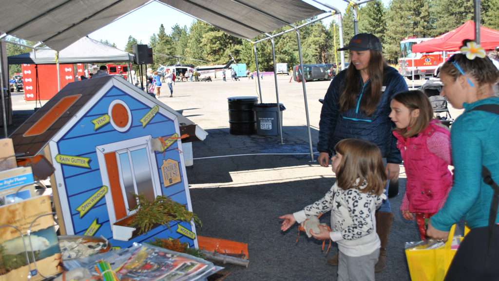 A family playing an ember house game